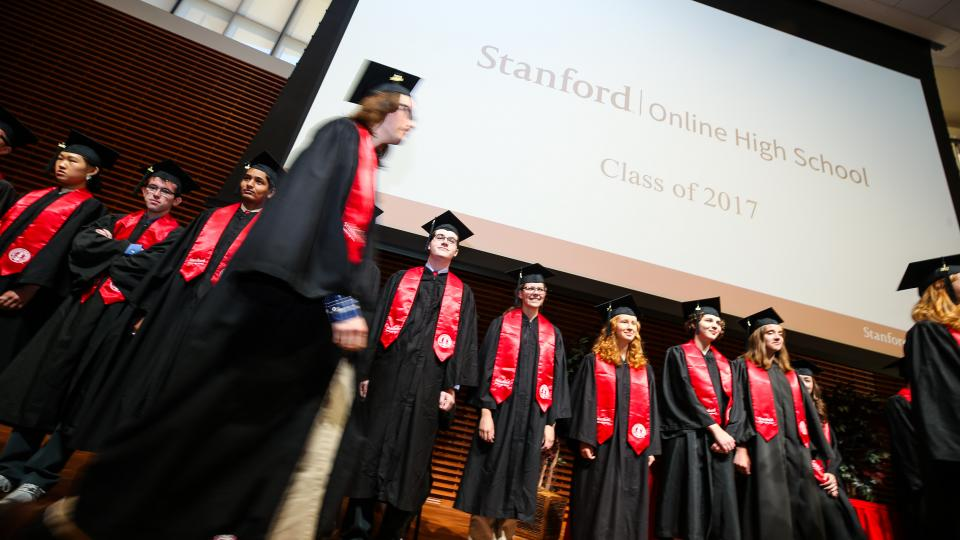 students on stage in robes